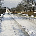 A Snow-covered Road Passes by Joel Sartore