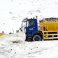 A Snow Plough Clearing A Road by Duncan Shaw