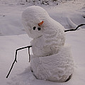 A Snowman Sitting In The Snow by Phil Schermeister