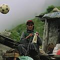 A Soccer Ball Flies Over The Head by Randy Olson