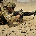 A Soldier Clears The Mk-48 Machine Gun by Stocktrek Images