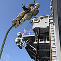 A Soldier Fast-ropes From The Rear by Stocktrek Images