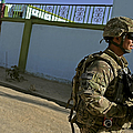 A Soldier Patrols The Streets Of Qalat by Stocktrek Images