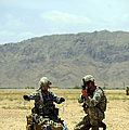 A Soldier Prepares A Drag Line While An by Stocktrek Images