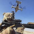 A Soldier Provides Security As An Mv-22 by Stocktrek Images