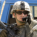 A Soldier Talking Via Radio by Stocktrek Images