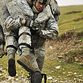 A Soldier Transports A Fellow Wounded by Stocktrek Images