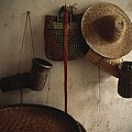 A Straw Hat, Straw Baskets And A Belt by James P. Blair