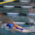 A Swimmer Races Through The Water by Michael S. Lewis