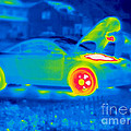A Thermogram Of A Man Working On A Car by Ted Kinsman