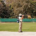 A Tourist Using A High Powered Camera Inside The Red Court In New Delhi by Ashish Agarwal