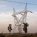 A Transmission Tower Carrying Electric Lines In The Countryside by Ashish Agarwal