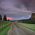 A Twilight View Down A Dirt Road by Bill Hatcher