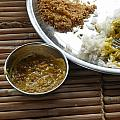 A Typical Plate Of Indian Rajasthani Food On A Bamboo Table by Ashish Agarwal