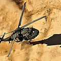 A Uh-60 Black Hawk Helicopter Comes by Stocktrek Images