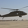 A Uh-60 Black Hawk Landing by Terry Moore