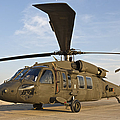 A Uh-60 Black Hawk Parked At A Military by Terry Moore