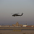 A Uh-60 Blackhawk Helicopter Flies by Terry Moore