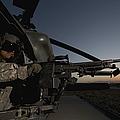 A Uh-60l Blackhawk Door Gunner Mans by Terry Moore