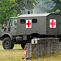 A Unimog In An Ambulance Version In Use by Luc De Jaeger