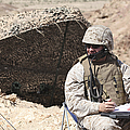 A U.s. Marine Communicates With Close by Stocktrek Images