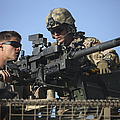 A U.s. Marine Fires A Gmg Automatic by Terry Moore
