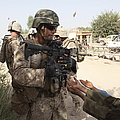 A U.s. Marine Gives A Piece Of Candy by Stocktrek Images