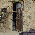 A U.s. Marine Searching by Stocktrek Images