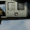 A U.s. Navy Naval Air Crewman Guides by Stocktrek Images