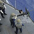 A U.s. Sailor Fires A .50-caliber M2hb by Stocktrek Images