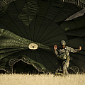 A U.s. Soldier Collapses His Parachute by Stocktrek Images