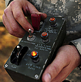 A U.s. Soldier Hits The Button by Stocktrek Images