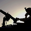 A U.s. Soldier Talks On A Hand Mike by Stocktrek Images
