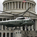 A Vh-60 Helicopter Lands In Front by Stocktrek Images