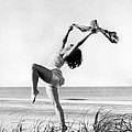 A Woman Dancing On The Shore by Underwood Archives