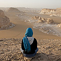 A Woman Sits Quietly On A Cliff Looking by Taylor S. Kennedy
