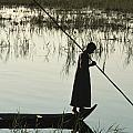A Woman Stands At The End Of A Rowboat by Lynn Abercrombie