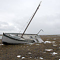 A Wooden Sailboat Is Beached by Pete Ryan