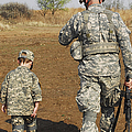 A Young Boy Joins His Squad Leader by Stocktrek Images