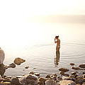 A Young Woman Wades Into The Dead Sea by Taylor S. Kennedy