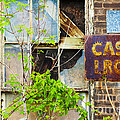 Abandoned Factory With Rusted Metal Sign by Gordon Wood