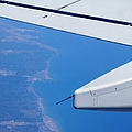 Aerial View II Airplane Flying Over Valencia In Spain Headed East Towards The Mediterranean Sea by John Shiron