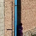 Afghan Girl In Doorway by Brittany Roth
