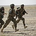 Afghan National Army Soldiers Run by Stocktrek Images