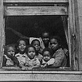 African American Woman And Six Children by Everett