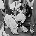 African American Woman Resisting by Everett
