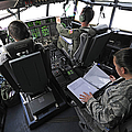 Aircrew Perform Preflight Checklists by Stocktrek Images