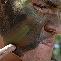 Airman Applies War Paint To His Face by Stocktrek Images