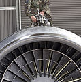 Airman Checks Components Atop A C-5 by Stocktrek Images
