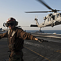 Airman Checks For A Clear Deck As An by Stocktrek Images